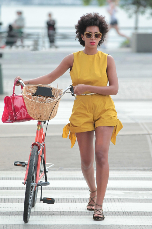 solange-mothers-day-azzedina-alaia-studded-suede-flat-sandals-yellow-jumpsuit