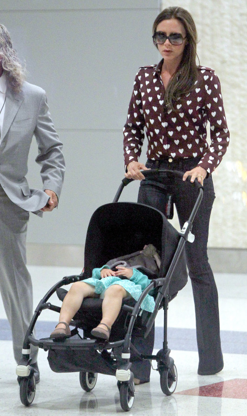 Victoria Beckham and Harper touch down in NYC **USA, Canada, Australia ONLY**